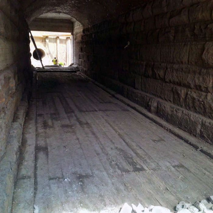 Completed sediment removal from inside the existing Avenue Louis Pasteur culvert revealed an existing timber flooring – late August 2015.