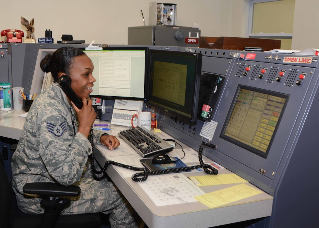 Staff Sgt. Shantel Ellis, 507th Air Refueling Wing command post controller coordinates with maintenance during the June Operational Exercise at Tinker Air Force Base, Okla. June 2, 2016. Command post controllers along with maintenance professionals in the maintenance operations center were tested by running numerous checklists, relaying command information, tracking aircraft, answering radio and phone calls while dispatching crews. (U.S. Air Force Photo/Tech Sgt. Lauren Gleason)
