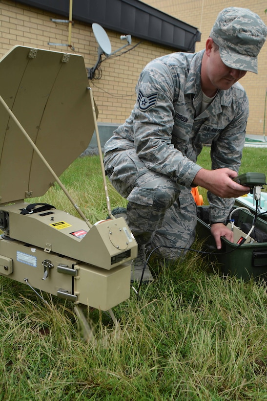 Staff Sgt. Colten Gibson of the 507th Air Refueling Wing Command Post configures a SCAMP (Single Channel Anti-Jam Man Portable) terminal during the June Operational Exercise at Tinker Air Force Base, Okla. The primary mission of SCAMP is to provide survivable extended-range communications to tactical units for command and control. (U.S. Air Force Photo/Tech Sgt. Lauren Gleason)