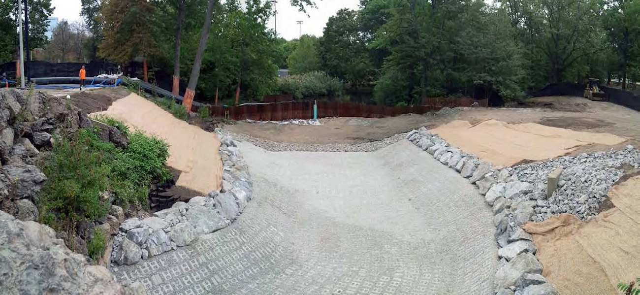 ACB's installed for channel bottom scour protection; stone protection and turf reinforced mattress installed for bank stabilization/restoration; and loam placed ready for plantings to complete this area of work – early September 2015.