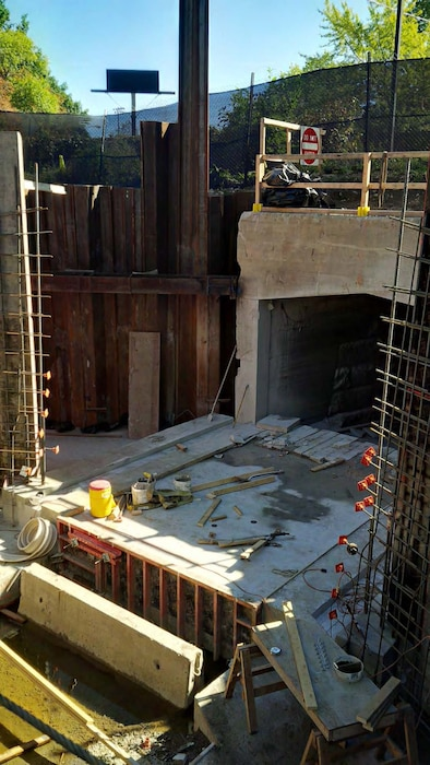 Note the new invert slab and the formwork and rebar for the wingwalls of the new precast concrete culvert extension – early October 2015.