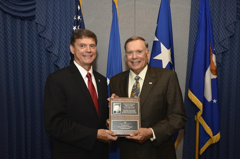 Kevin Williams, the director of Air Force Studies, Analyses and Assessments, presents the Lt. Gen. Glenn A. Kent Leadership Award to former Air Force Chief of Staff Gen. John P. Jumper at the Pentagon on June 11, 2016. The Kent award recognizes influential leaders who've had substantive analytic responsibilities during their career and whose vision and leadership have had a significant and lasting effect on the achievements of Air Force analysis. (U.S. Air Force photo/Tech. Sgt. Anthony Nelson Jr.)