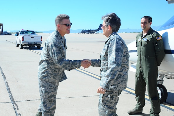 U.S. Air Force Brigadier General Steven Bleymaier, commander of Ogden Air Logistics Complex, greets General Ellen Pawlikowski, commander of Air Force Materiel Command, at Davis-Monthan Air Force Base, Ariz., July 12, 2016. The mission of the Air Force Materiel Command is to 
