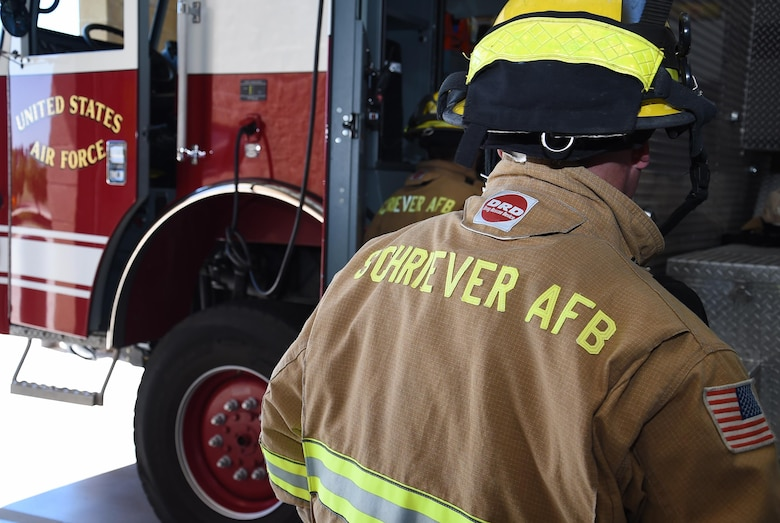 Firefighters from the Schriever Air Force Base Fire Department, prepare to respond to a simulated emergency at Schriever Air Force Base, Monday, July 11, 2016. Their training consists of proficiency, critical and local area training. Every position has a certain amount of proficiency training that is needed throughout the year per their core job description. (U.S. Air Force Photo/Staff Sgt. Matthew Coleman-Foster)