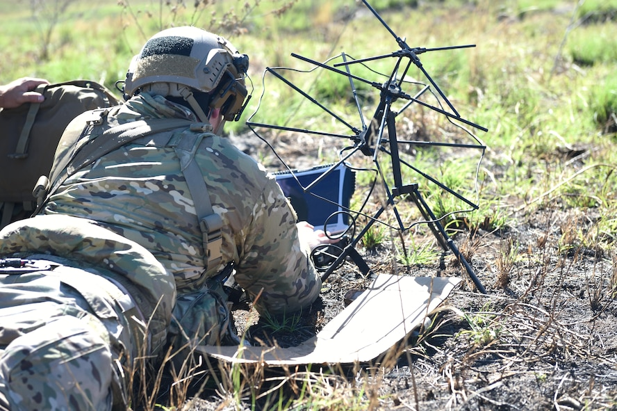 An Air Force combat controller with the 320th Special Tactics Squadron sends data over a network using a satellite communication antenna and a laptop during a humanitarian assistance and disaster response scenario as part of Rim of the Pacific (RIMPAC) 2016, Pohakuloa Training Area, Hawaii, July 10, 2016. RIMPAC offers the 320th STS and III Marine Expeditionary Force an opportunity to team up and practice their unique skills to strengthen their partnership in order to respond to crises quickly. (U.S. Air Force photo by 2nd Lt. Jaclyn Pienkowski/Released)