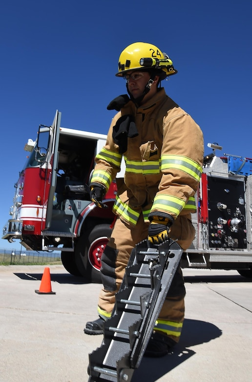 Kenny Gestes, Schriever Air Force Base Fire Department firefighter, handles the Shark, a collapsible step cribbing, which is used to stabilize, extricate, and rescue accident victims during a simulated emergency at Schriever Air Force Base, Monday, July 11, 2016.  The firefighters are in a ready posture 24 hours a day including holidays, down days and weekends. They have a normal workday which consists of routine vehicle maintenance, training and details. (U.S. Air Force Photo/Staff Sgt. Matthew Coleman-Foster)