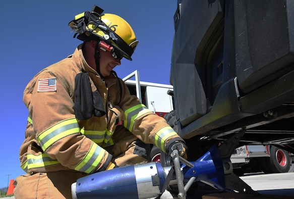 Jerame Bullard, 50th Civil Engineering Squadron firefighter, handles the Jaws of Life, a hydraulic apparatus used to pry apart the wreckage of crashed vehicles in order to free people trapped inside, during a simulated emergency at Schriever Air Force Base, Monday, July 11, 2016. This year, the fire department earned top bragging rights as Air Force Space Command's Small Fire Department of the Year. This is the fourth time in the last five years they have earned this honor. (U.S. Air Force Photo/Staff Sgt. Matthew Coleman-Foster)
