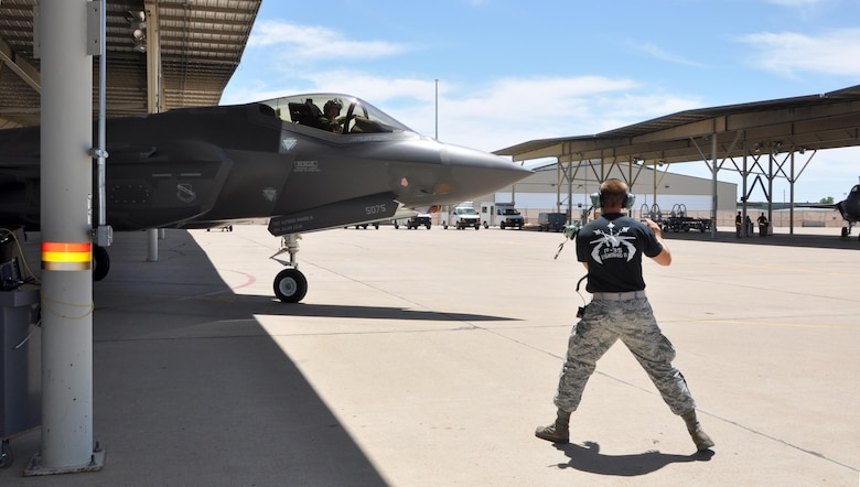 Staff Sgt. Jordon Tuck, crew chief in the 419th Maintenance Group, directs an F-35A as it taxies to the runway here July 9. This weekend marks the first time reservists in the 419th Fighter Wing conducted F-35 operations and maintenance independent of their active duty counterparts. (U.S. Air Force photo/Staff Sgt. Christina Judd)