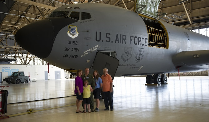 Col. Brian McDaniel, 92nd Air Refueling Wing commander, poses in front of a KC-135 Stratotanker with his family July 13, 2016, at Fairchild Air Force Base, Wash. After departing Fairchild McDaniel will be headed to Scott Air Force Base to fill the position of vice commander 618th Air Operations Center(Tanker Airlift Control Center).  (U.S. Air Force photo/ Airman 1st Class Sean Campbell)