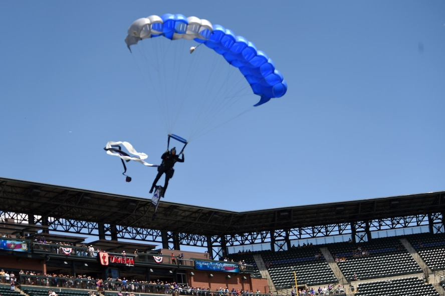 U.S. Air Force skydiving team member with the Wings of Blue parachutes into Coors Field July 10, 2016, in Denver. during a military appreciation ceremony. The Wings of Blue demonstration team takes part in events across the country, such as airshows, sporting events and other events to represent the Air Force. (U.S. Air Force photo by Airman 1st Class Gabrielle Spradling/Released)