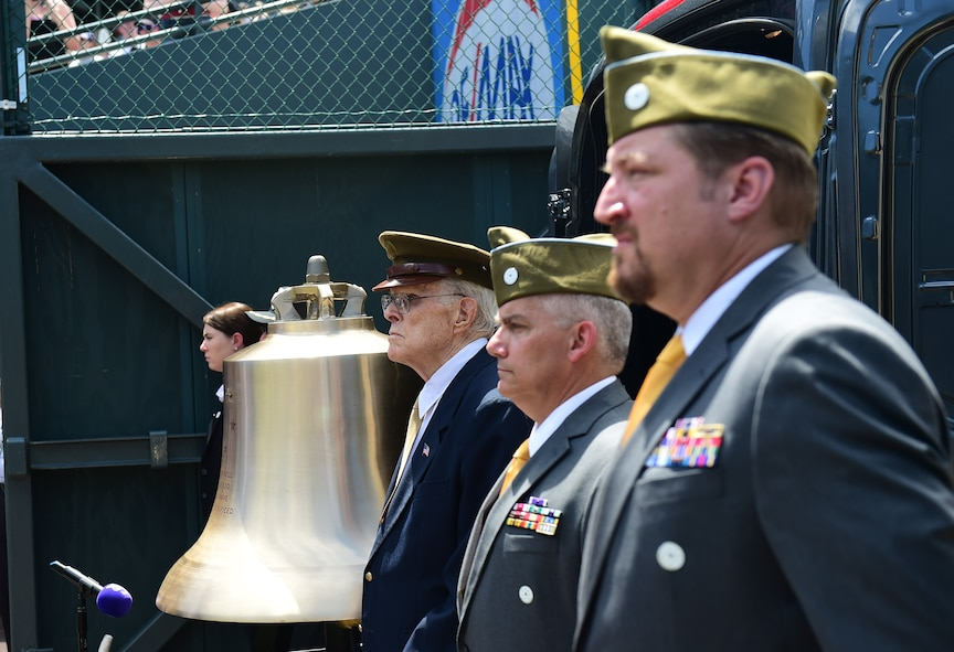 Veterans take part in a military appreciation ceremony July 10, 2016, during the pre-game activities of a Colorado Rockies game at Coors Field in Denver. The veterans had the privilege of ringing the Honor Bell, which is dedicated to those who have served and sacrificed. (U.S. Air Force photo by Airman 1st Class Gabrielle Spradling/Released)