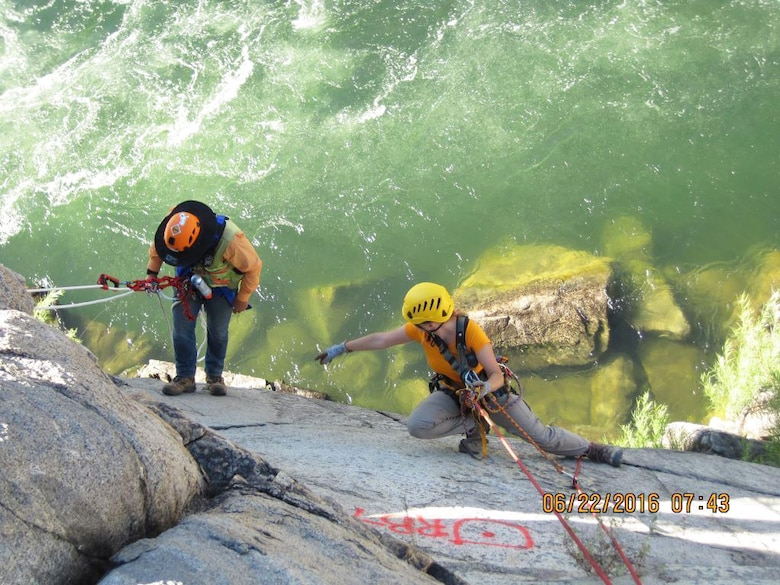 Coralie Wilhite, a geological engineer for the U.S. Army Corps of Engineers Sacramento District, marks rock bolt anchor locations on the bank of the American River near Folsom Dam as part of the Joint Federal Project.