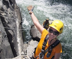 Coralie Wilhite, a geological engineer for the U.S. Army Corps of Engineers Sacramento District, rappels down a rock face along the bank of the American River near Folsom Dam to mark rock bolt anchor locations as part of the Joint Federal Project.