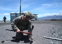 Cpl. Andrew White, a motor transportation operator, hammers a stake into the ground that will support a large antenna on Range 1, near the Pohakuloa Training Area, Hawaii, July 8, 2016. The antenna will be used to broaden Marines' area of communication during Rim of the Pacific 2016. Twenty-six nations, 49 ships, six submarines, about 200 aircraft, and 25,000 personnel are participating in Rim of the Pacific 2016 from June 29 to Aug. 4 in and around the Hawaiian Islands and Southern California. The world's largest international maritime exercise, RIMPAC provides a unique training opportunity while fostering and sustaining cooperative relationships between participants critical to ensuring the safety of sea lanes and security on the world's oceans. RIMPAC 16 is the 25th exercise in the series that began in 1971. White, a native of Memphis, Tennessee, is with 3rd Marine Regiment, 3rd Marine Division, III Marine Expeditionary Force.