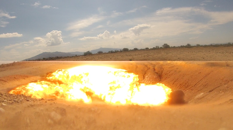 A charge is detonated during an explosive ordnance disposal immersion course at Davis-Monthan Air Force Base, Ariz., June 28, 2016. The immersion course serves a dual purpose of showing Airmen interested in retraining into EOD exactly what the specialty's technicians do on a regular basis and also determines if the candidate is right for the job. (U.S. Air Force photo by Senior Airman Samuel O'Brien/Released)