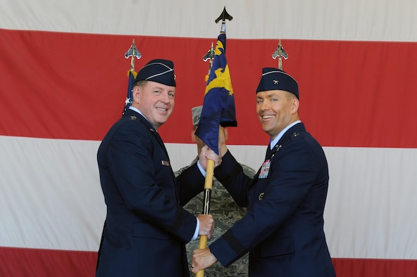 Maj. Gen. James Hecker, 19th Air Force commander, hands the guidon to the incoming commander Brig. Gen. Brook Leonard at Luke Air Force Base, Arizona, July 13, 2016. Leonard will be the commander of the 56th Fighter Wing. (U.S. Air Force photo by Airman 1st Class Pedro Mota)
