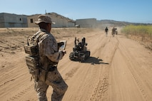 Pfc. Edgar Langle, an infantryman with 3rd Battalion, 5th Marine Regiment, operates a newly developed Modular Advanced Armed Robotic System in a field environment at Marine Corps Base Camp Pendleton, Calif., July 8, 2016.  The system was built by the Marine Corps Warfighting Laboratory to assist Marines in carrying gear and clearing buildings.  The lab is conducting a Marine Air-Ground Task Force Integrated Experiment in conjunction with Rim of the Pacific exercise to explore new gear and assess its capabilities for potential future use. The Warfighting Lab identifies possible challenges of the future, develops new warfighting concepts, and tests new ideas to help develop equipment that meets the challenges of the future operating environment.