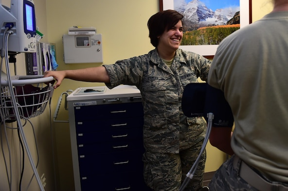 Airman 1st Class Sarah Atamian, 460th Medical Group flight medicine medical technician, checks the blood pressure of a patient June 30, 2016, on Buckley Air Force Base, Colo. Atamian hopes to use the skills she learns as a medical technician to help others one day as a chaplain. (U.S. Air Force photo by Airman 1st Class Gabrielle Spradling/Released)