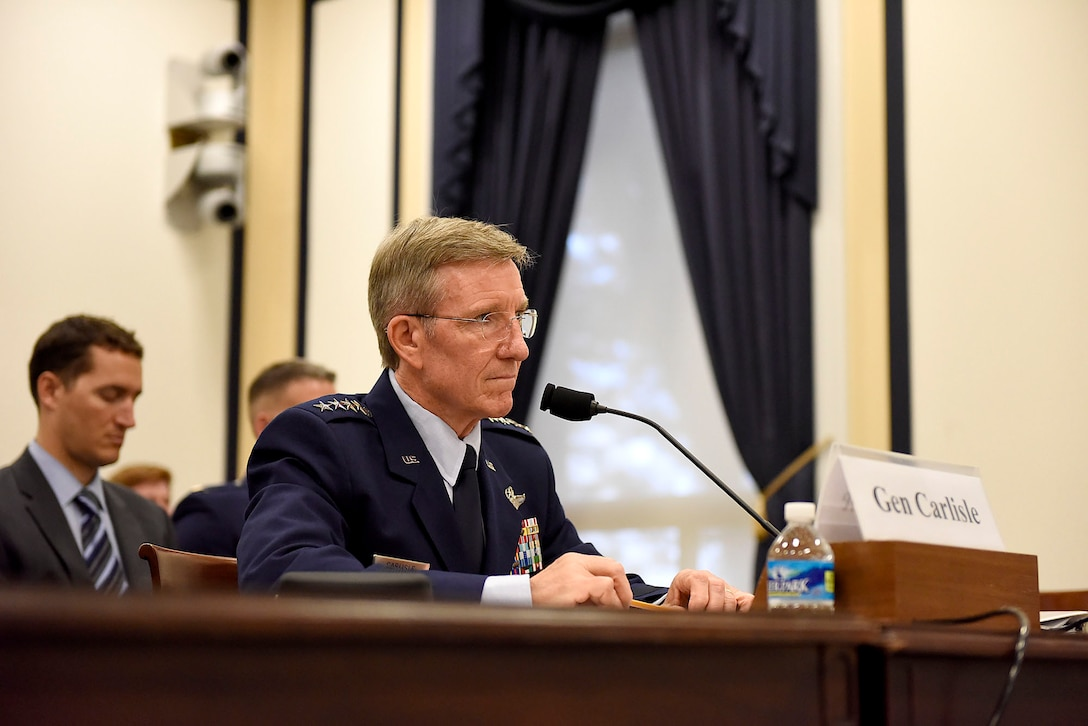 U.S Air Force Gen. Hawk Carlisle, commander of Air Combat Command, engages with the House Armed Services Subcommittee on Tactical Air and Land Forces during a hearing in Washington, D.C., July 13, 2016. The purpose of his testimony involved the importance of air superiority and the need to assure it by modernizing the Combat Air Force. (U.S. Air Force photo/Senior Airman Hailey Haux)
