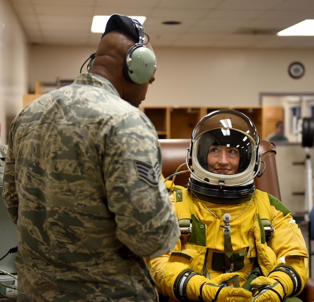 Staff Sgt. Reginald Randolph, 9th Physiological Support Squadron aerospace physiology technician, speaks with Christina Koch, NASA astronaut, regarding her experience in a full-pressure suit July 7, 2016, at Beale Air Force Base, California. Koch is undergoing Space Flight Readiness Training. (U.S. Air Force photo/ Senior Airman Bobby Cummings)