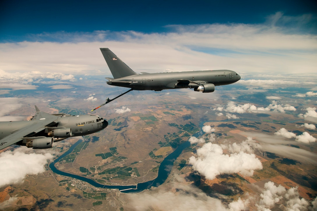 "Boeing's KC-46 aerial refueling tanker conducts receiver compatibility tests with a U.S. Air Force C-17 Globemaster III from Joint Base Lewis-McChord as part of Test 003-06. The event marks the nearing completion of ""Milestone C"" in the new tanker's developmental testing stage. (U.S. Air Force photo by Christopher Okula)"
