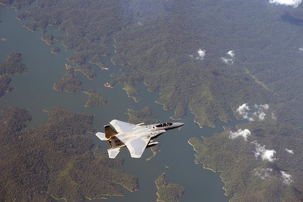 In this photo file, a U.S. Air Force F-15 Eagle from the 131st Fighter Squadron, 104th Fighter Wing, Barnes Air National Guard Base, Mass., flies over Penang, Malaysia, during Cope Taufan 14, June 18, 2014. Cope Taufan is a biennial large force employment exercise taking place June 9 to 20 designed to improve U.S. and Malaysian combined readiness.