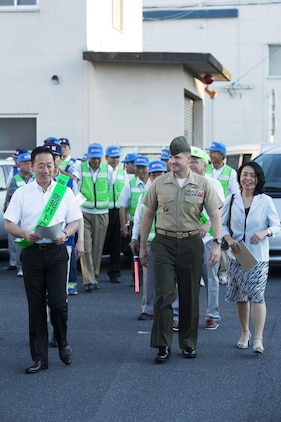 U.S. Marine Corps Col. Robert V. Boucher, commanding officer of Marine Corps Air Station Iwakuni, and the Honorable Yoshihiko Fukuda, mayor of Iwakuni, lead the crowd and local Japanese media down the streets of Iwakuni during the seventh Joint Leadership Walk on July 6, 2016. The last walk took place in December 2015 and continues to be a firm demonstration of the bond and unity between both communities. (U.S. Marine Corps photo by Lance Cpl. Donato Maffin/Released)