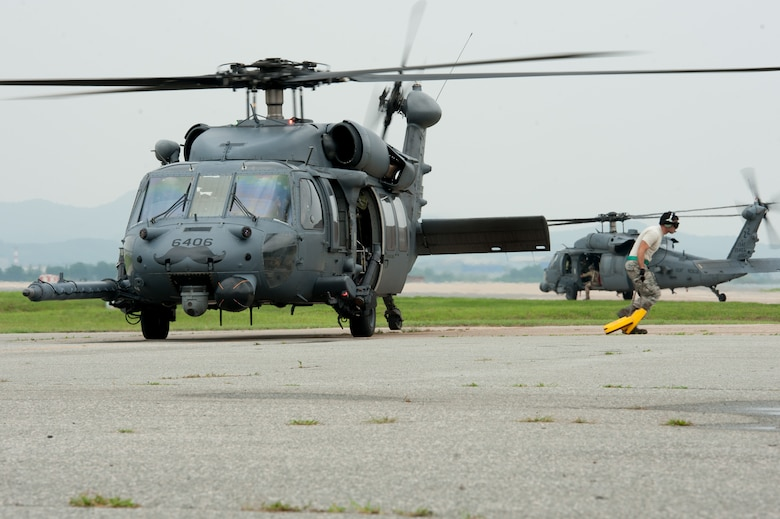 Senior Airman Paul Roberts, 33rd Helicopter Maintenance Unit crew chief, pulls chalks from an HH-60G Pave Hawk assigned to the 33rd Rescue Squadron prior to a flight during Exercise Pacific Thunder 16-2 at Osan Air Base, Republic of Korea, July 12, 2016. The 33rd RQS is participating in Pacific Thunder, the largest Pacific combined joint exercise in which U.S. and ROK forces train and test combat search and rescue skills. (U.S. Air force photo by Staff Sgt. Jonathan Steffen/Released)