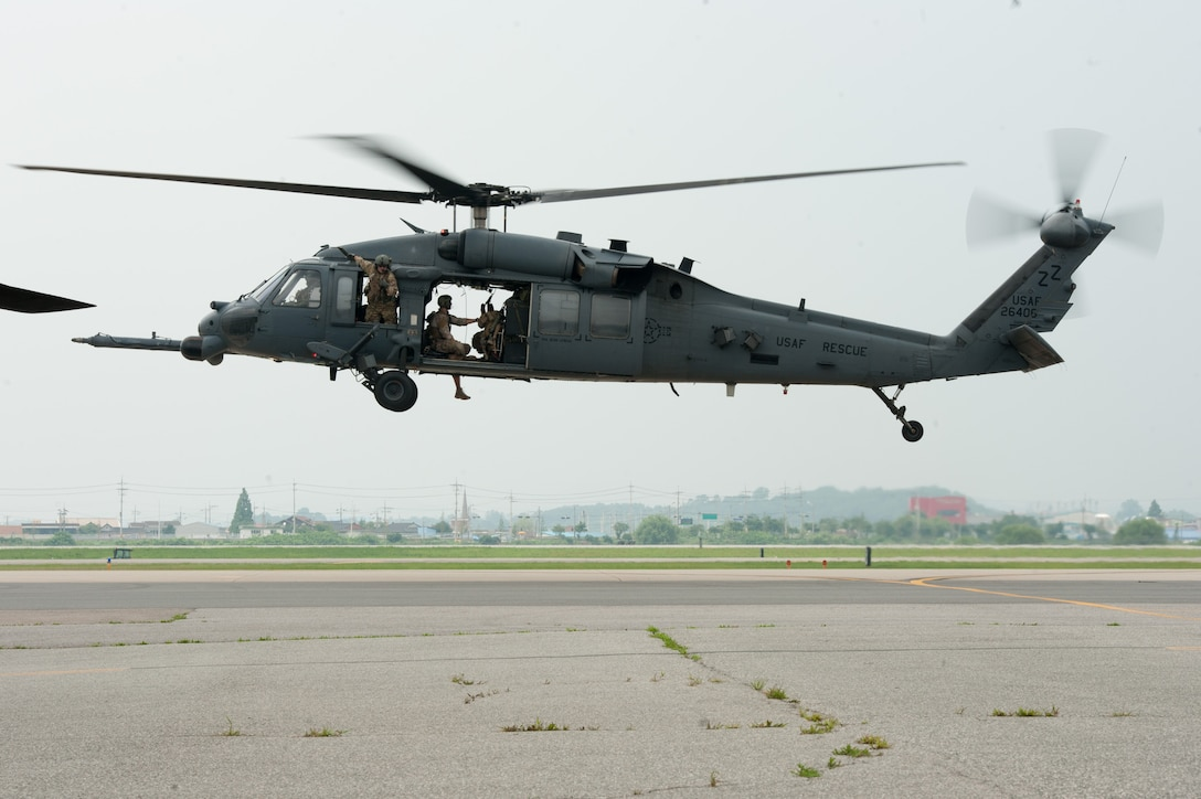 An HH-60G Pave Hawk assigned to the 33rd Rescue Squadron takes off during Exercise Pacific Thunder 16-2 at Osan Air Base, Republic of Korea, July 12, 2016. The 33rd RQS is participating in Pacific Thunder, the largest Pacific combined joint exercise in which U.S. and ROK forces train and test combat search and rescue skills. (U.S. Air Force photo by Staff Sgt. Jonathan Steffen/Released)