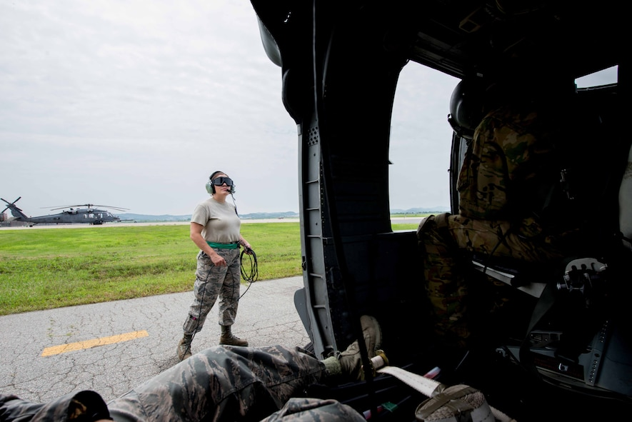 Senior Airman Gricelda Tomson, 33rd Helicopter Maintenance Unit guidance flight control technician, watches as an HH-60G Pave Hawk assigned to the 33rd Rescue Squadron starts up during Exercise Pacific Thunder 16-2 at Osan Air Base, Republic of Korea, July 13, 2016. The 33rd RQS comes to Osan to participate in Pacific Thunder to train their combat search and rescue capabilities. (U.S. Air Force photo by Staff Sgt. Jonathan Steffen/Released)
