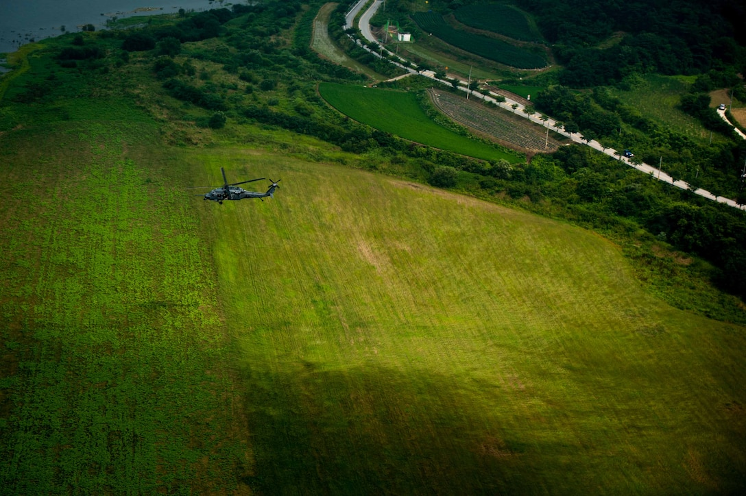 An HH-60G Pave Hawk assigned to 33rd Rescue Squadron flies over Republic of Korea countryside during Exercise Pacific Thunder 16-2, July 13, 2016. The 33rd RQS comes to Osan AB, ROK, for Pacific Thunder to train their combat search and rescue capabilities. (U.S. Air Force photo by Staff Sgt. Jonathan Steffen/Released)
