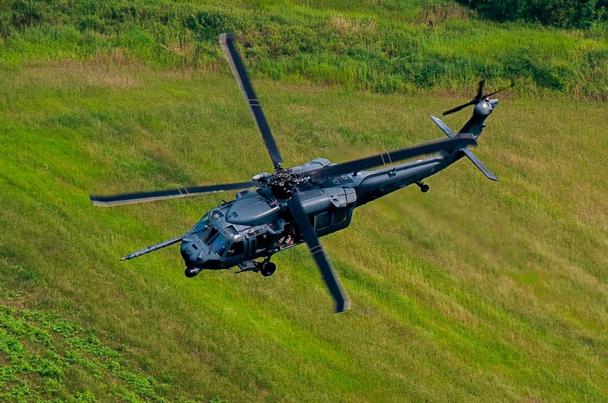 An HH-60G Pave Hawk assigned to 33rd Rescue Squadron flies over Republic of Korea air space for Exercise Pacific Thunder 16-2, July 13, 2016. The 33rd RQS comes to Osan AB, ROK, for Pacific Thunder to train their combat search and rescue capabilities. (U.S. Air Force photo by Staff Sgt. Jonathan Steffen/Released)