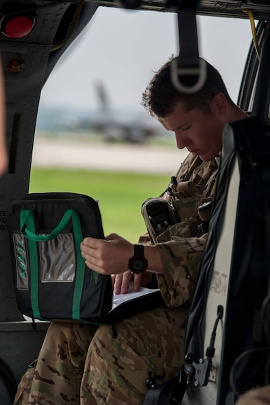 Staff Sgt. Joe Arriza, 33rd Rescue Squadron aerial gunner, looks over a preflight checklist before a combat search and rescue scenario during Exercise Pacific Thunder 16-2 at Osan Air Base, Republic of Korea, July 13, 2016. The 33rd RQS is at Osan to participate in Pacific Thunder, the largest combat search and rescue exercise in the Pacific. (U.S. Air Force photo by Staff Sgt. Jonathan Steffen/Released)