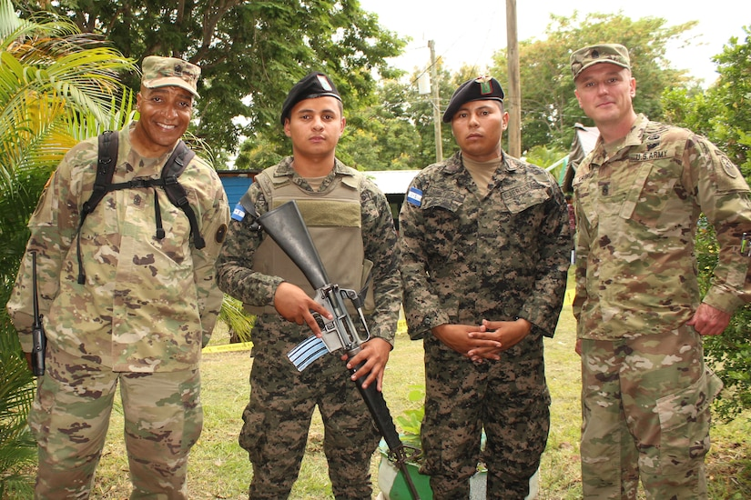 Comayagua, Honduras – U.S. Army Sergeant Major Archie Smith (far left), Joint Task Force-Bravo Medical Element clinical operations, and Sergeant Major Shawn Carns (far right), JTF-Bravo Command Sergeant Major, pose for photo with Honduran Army service members during a Military Partnership Engagement in San Sebastian, Comayagua, Honduras, July 9, 2016.  MPEs provide an opportunity to engage with the community while supporting the Honduran military efforts in providing care for the local population. (U.S. Army photo by Maria Pinel)
