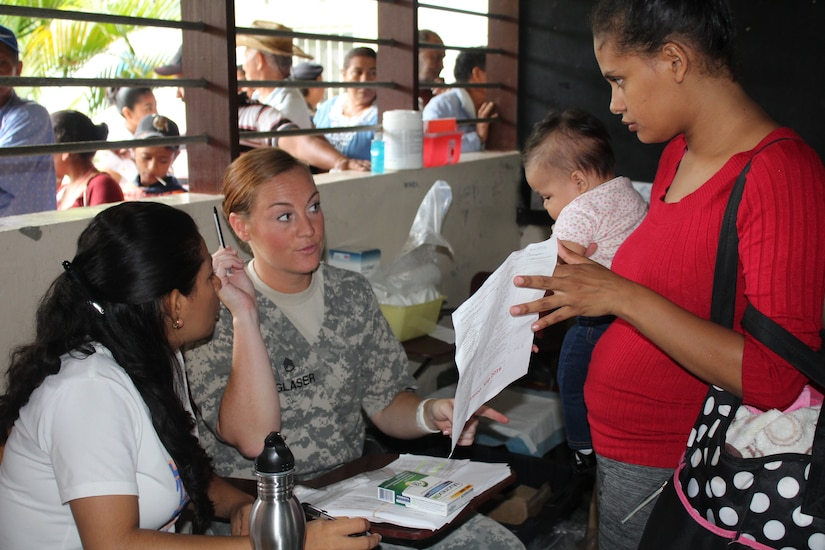 Comayagua, Honduras – U.S. Army Staff Sgt. Melissa Glaser explains a prescription to a Honduran woman with the help of a Spanish translator, during a Military Partnership Engagement between JTF-Bravo and CEDACE in San Sebastian, Comayagua, Honduras, July 9, 2016.  JTF-Bravo participated in the humanitarian mission at the request of the Military Commander of CEDACE.  (U.S. Army photo by Maria Pinel)