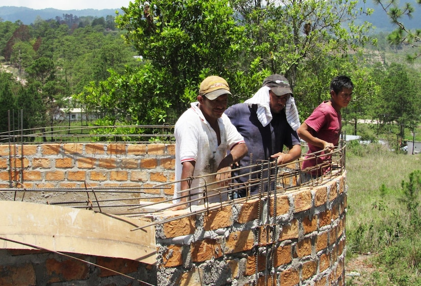 Honduran construction workers take a rest from building a new water well in Comayagua, Honduras, June 14, 2016, where members of Joint Task Force-Bravo's Medical Element Preventive Medicine team visited to test the water. The MEDEL team provides the community with water purification testing and education on different ways of maintaining a clean water supply in cooperation with the Honduran Ministry of Health of Comayagua. (U.S. Army photo by 1Lt Jenniffer Rodriguez)