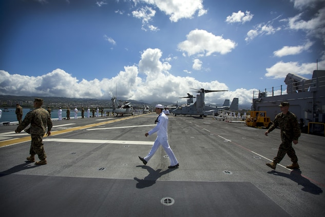 U.S. Marines and sailors march to their designated saluting position minutes before USS America leaves port July 12, 2016. III Marine Expeditionary Forces will conduct mission rehearsals of landing force integration with an amphibious task force during Rim of the Pacific 2016. Twenty-six nations, 49 ships, six submarines, about 200 aircrafts, and 25,000 personnel are participating in RIMPAC 2016 from June 29 to Aug. 4 in and around the Hawaiian Islands and Southern California. The world's largest international maritime exercise, RIMPAC provides a unique training opportunity while fostering and sustaining cooperative relationships between participants critical to ensuring the safety of sea lanes and security on the world's oceans.