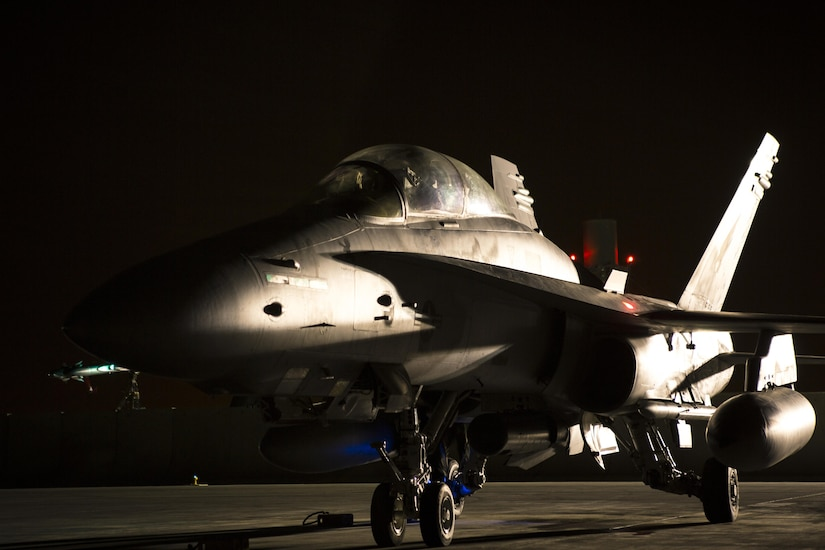 An F/A-18D Hornet assigned to Marine All-Weather Fighter Attack Squadron 533, Special Purpose Marine Air Ground Task Force - Crisis Response - Central Command 16.2, returns to an undisclosed location in Southwest Asia, June 8, 2016. VMFA(AW)-533 operates and conducts strikes as part of the Aviation Combat Element of SPMAGTF-CR-CC in support of Operation Inherent Resolve, the operation to eliminate the ISIL terrorist group and the threat they pose to Iraq, Syria, and the wider international community. (U.S. Marine Corps photo by Sgt. Donald Holbert/ Released)