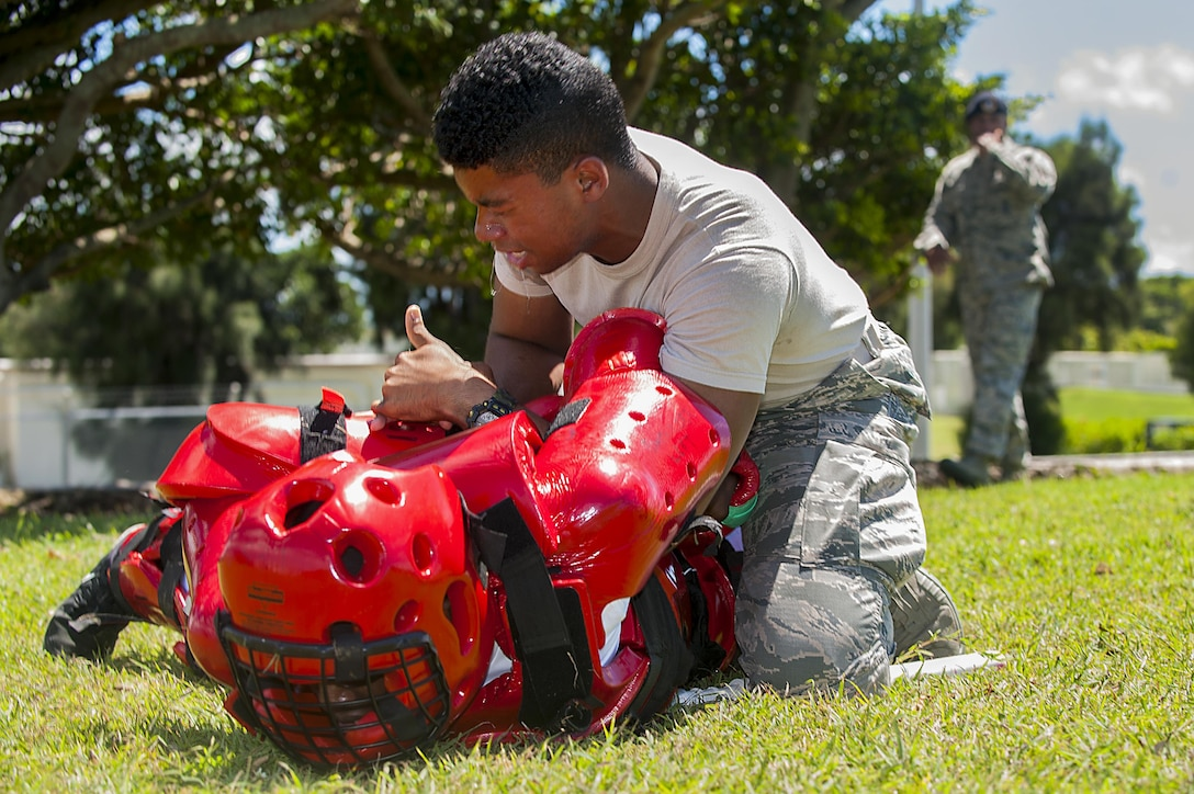 U.S. Air Force Airman 1st Class Zahn Hicks, 18th Security Forces Squadron response force member, takes down an attacker in a red-man suit after being sprayed in the eyes with OC spray during training July 13, 2016, at Kadena Air Base, Japan. Security forces member have to be ready for any situation, including being sprayed with OC spray and still having to fight back and subdue an attacker. (U.S. Air Force photo by Airman 1st Class Corey M. Pettis)