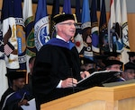 NIU President Dr. David Ellison, shown here welcoming new students at a recent convocation ceremony, announced plans to retire in August 2017 after the university completes its move to Bethesda.