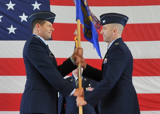 U.S. Air Force Col. Michael Hernandez, 325th Fighter Wing commander (left), presents the 325th Medical Group guidon to its new commander, Col. Scott McKim, during the 325th MDG change of command ceremony July 13. McKim previously served as deputy commander of the 374th Medical Group at Yokota Air Base, Japan. The 325th MDG is comprised of more than 300 medical professionals and support staff and provides medical services to approximately 36,000 individuals in the Tyndall community. (U.S. Air Force photo by Senior Airman Ty-Rico Lea/Released)