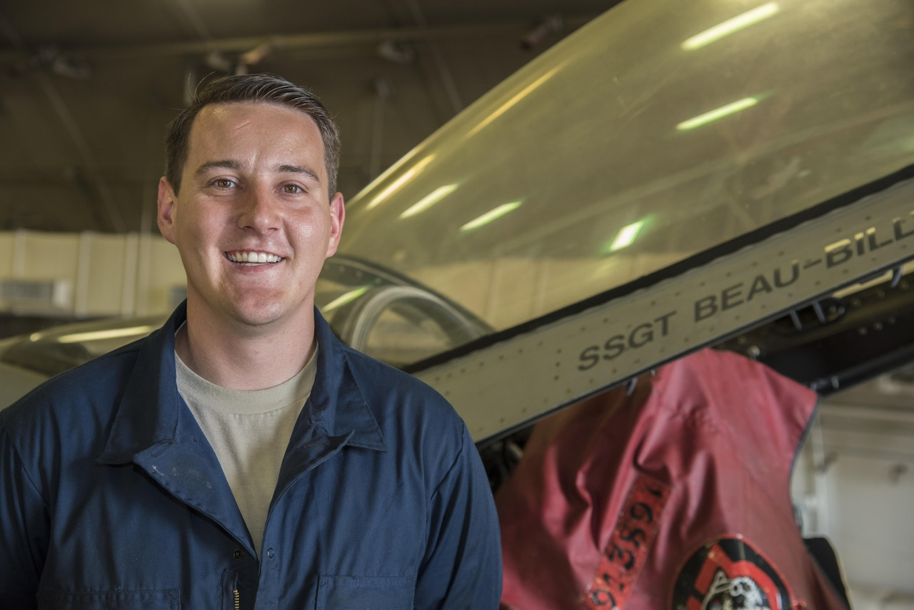 Air Force Staff Sgt. Beau Blackburn, a dedicated crew chief with the 35th Aircraft Maintenance Squadron, poses for a photograph next to an F-16 Fighting Falcon canopy at Misawa Air Base, Japan, June 16, 2016. When a crew chief is assigned to an aircraft, their name is printed below the bubble canopy. This tradition signifies the responsibility each crew chief has to keep their aircraft in perfect working order, ensuring its reliability. Air Force photo by Airman 1st Class Jordyn Fetter