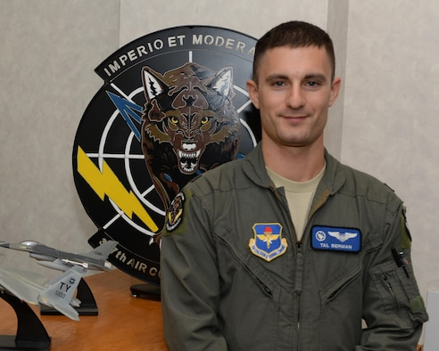 First Lieutenant Tal Berman, 337th Air Control Squadron instructor poses in front of the squadron emblem at Tyndall Air Force Base, Fla. July 13, 2016. Berman joined the Air Force after he discovered his passion for leadership and helping people grow both professionally and personally. (U.S. Air Force photo by Airman 1st Class Cody R. Miller/Released)