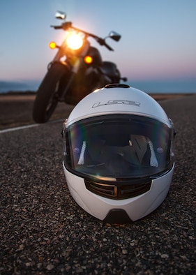 A motorcycle helmet rests on the side of the road in Minot, N.D., April 9, 2016. During the summer, a great way to enjoy the area is to start up the motorcycle and hit the road. (U.S. Air Force photo/J.T. Armstrong)