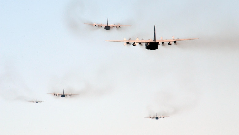 C-130 Hercules from the 700th Airlift Squadron take off in formation from Dobbins Air Reserve Base, Ga., on July 9, 2016. The 94th Airlift Wing formation conducted proficiency training missions over downtown Atlanta and much of the metro area. (U.S. Air Force photo/Tech. Sgt. Kelly Goonan)