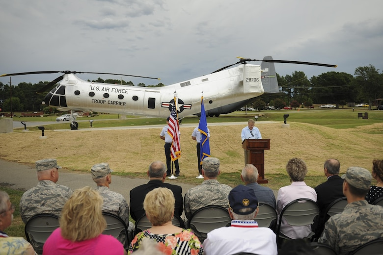 Mark Wilderman, 314th Airlift Wing historian, explains the heritage of the H-21B to a group of Airmen and civic leaders July 14, 2016, at Little Rock Air Force Base, Ark. The H-21B is the newest static display aircraft to enter into the Little Rock AFB fleet at Heritage Park. (U.S. Air Force photo/Senior Airman Harry Brexel)
