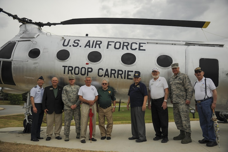 U.S. Air Force veterans and Team Little Rock leaders commemorate the H-21B helicopter static display July 14, 2016, at Little Rock Air Force Base, Ark. The assault helicopter was originally delivered to the Air Force in 1955 and was known as a tactical airlift workhouse. (U.S. Air Force photo/Senior Airman Harry Brexel)