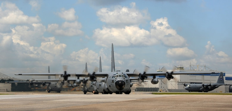 C-130s from the 94th Airlift Wing travel down the ramp at Dobbins Air Reserve Base, Ga. after a formation flight on July 9, 2016. The formation's flight path traversed over the metro Atlanta area and gave the wing's Airmen a chance to showcase their skills in view of the local community. (U.S. Air Force photo by Staff Sgt. Alan Abernethy)