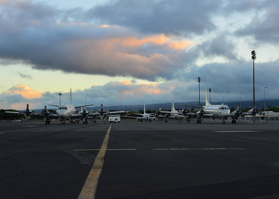 U.S. Navy P-3C Orion aircraft from Marine Corps Air Station Kaneohe Bay, Hawaii site on the flightline of Joint Base Pearl Harbor-Hickam during the Rim of the Pacific Exercises 11 June, 2016. Twenty-six nations, 49 ships, six submarines, about 200 aircraft, and 25,000 personnel are participating in Rim of the Pacific 2016 from June 29 to Aug. 4 in and around the Hawaiian Islands and Southern California. The world's largest international maritime exercise, RIMPAC provides a unique training opportunity while fostering and sustaining cooperative relationships between participants critical to ensuring the safety of sea lanes and security on the world's oceans. RIMPAC 16 is the 25th exercise in the series that began in 1971. (U.S. Air Force photo by Tech. Sgt. Aaron Oelrich)