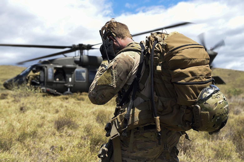An Air Force combat controller with the 320th Special Tactics Squadron coordinates with a UH-60 Blackhawk for take off during a humanitarian assistance and disaster response scenario as part of Rim of the Pacific (RIMPAC) 2016, Pohakuloa Training Area, Hawaii, July 10, 2016. Twenty-six nations, more than 40 ships and submarines, more than 200 aircraft and 25,000 personnel are participating in RIMPAC from June 30 to Aug. 4, in and around the Hawaiian Islands and Southern California. The world's largest international maritime exercise, RIMPAC provides a unique training opportunity that helps participants foster and sustain the cooperative relationships that are critical to ensuring the safety of sea lanes and security on the world's oceans. RIMPAC 2016 is the 25th exercise in the series that began in 1971.(U.S. Air Force photo by 2nd Lt. Jaclyn Pienkowski/Released)